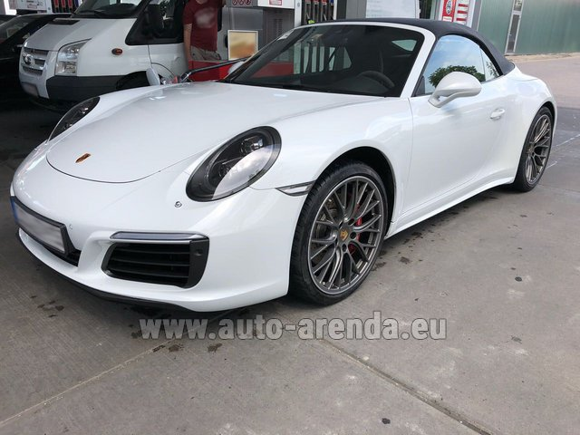 Hire and delivery to Amsterdam Airport Schiphol the car Porsche 911 Carrera Cabrio White